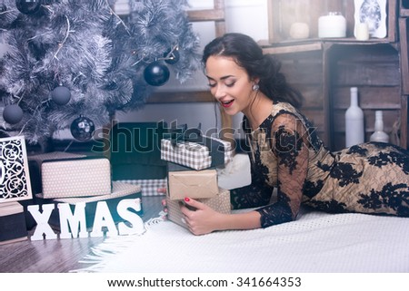 Young beautiful woman at christmas night with presents - stock photo