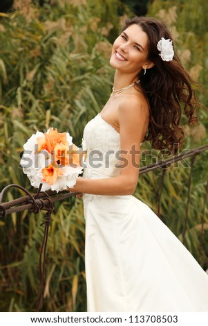 young beautiful woman bride's portrait on the bridge, summer nature outdoor - stock photo