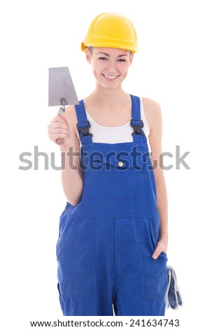 young beautiful woman builder in blue coveralls with trowel isolated on white background - stock photo