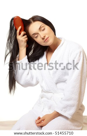 young beautiful woman do her   healthy hair - stock photo