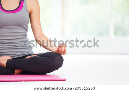 Young beautiful woman doing yoga indoors. - stock photo