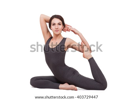 young beautiful woman doing yoga isolated on white - stock photo