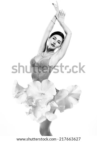 Young beautiful woman dressed in elegant dress of fresh white flowers, black and white - stock photo