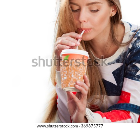 Young beautiful woman drinking coffee - stock photo