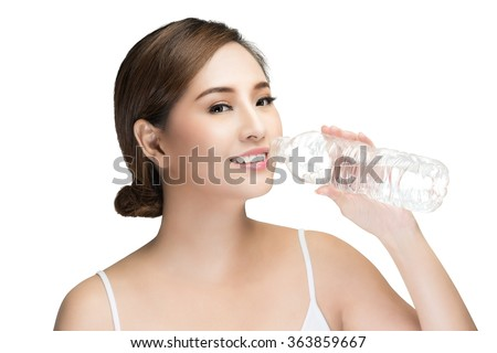 young Beautiful woman drinking water,  isolated on white with clipping path. - stock photo