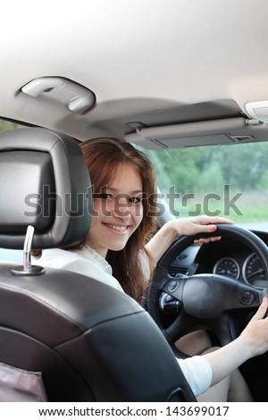 young beautiful woman driving a car - stock photo