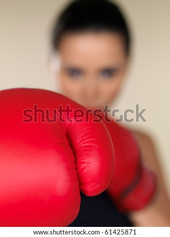Young beautiful woman during fitness and boxing - stock photo