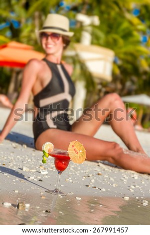 young beautiful woman enjoying summer vacations on tropical beach, outdoor portrait - stock photo