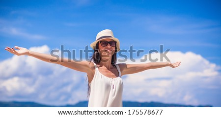 Young beautiful woman enjoying the holiday on white tropical beach - stock photo