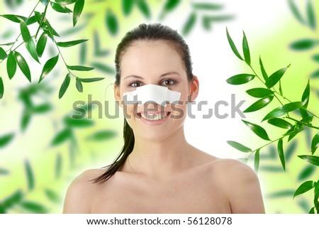 Young beautiful woman face after nose surgery - stock photo