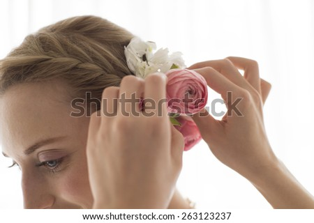 Young beautiful woman getting her hair done - stock photo