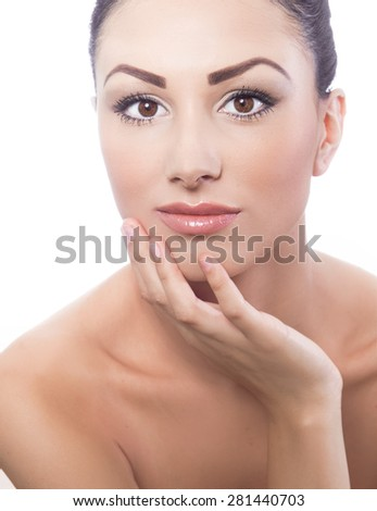 Young beautiful woman has put to cheek with her finger or hand,  Isolated on white background, studio shot. Portrait of a young beauty girl - stock photo