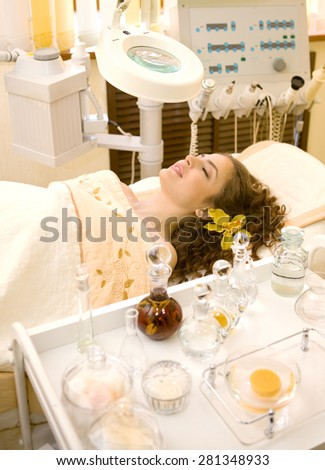 Young beautiful woman having beauty teatment in the beauty shop with the morden beauty equipment. - stock photo