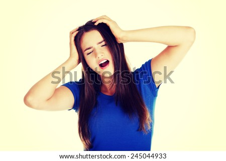 Young beautiful woman having terrible headache.  - stock photo