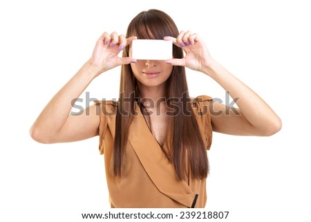 Young beautiful woman holding a blank credit card size paper. Close-up of a blank business card in young beautiful woman hand. You can put your text. - stock photo