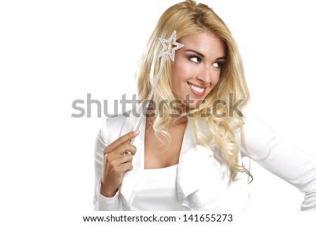 young beautiful woman holding a magic wand  on white - stock photo