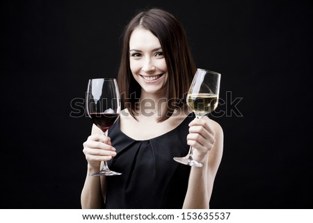 young beautiful woman holding glass of red and white wine - stock photo
