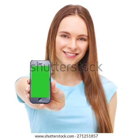Young beautiful woman holding smartphone with copyspace - isolated on white background. - stock photo