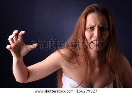 Young beautiful woman in a rage - stock photo