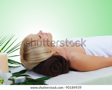 Young beautiful woman in a spa salon massage procedure - stock photo