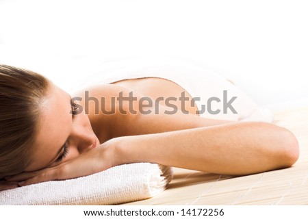 young beautiful woman in a spa with towels - stock photo