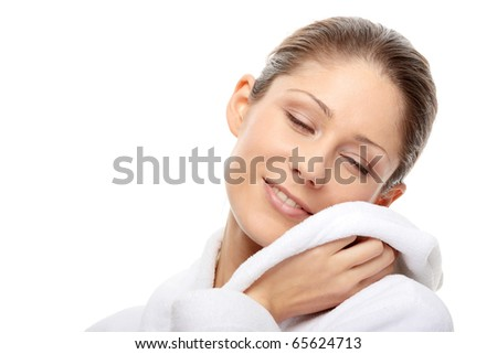 Young beautiful woman in bathrobe, isolated on white - stock photo