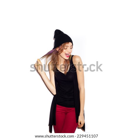 Young beautiful woman in black beanie.  White background, not isolated - stock photo