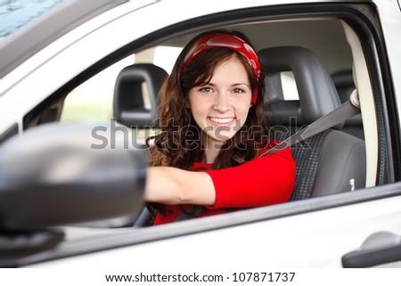 Young beautiful woman in car - stock photo