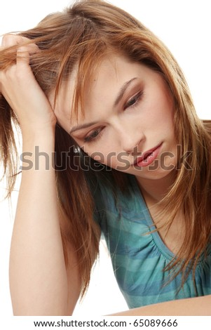 Young beautiful woman in depression, isolated on white - stock photo
