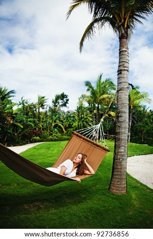 Young beautiful woman in hammock, Bali, Indonesia - stock photo