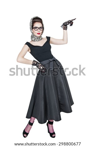 Young beautiful woman in retro pin up style showing on something by hand isolated  - stock photo