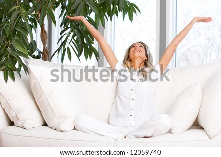 Young beautiful woman  in the new  comfortable apartment - stock photo