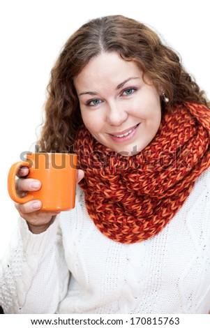 Young beautiful woman in white sweater with a cup in hand, isolated on white background - stock photo