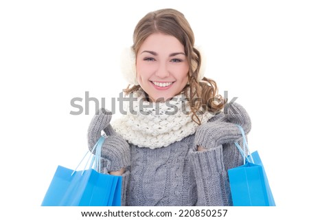 young beautiful woman in winter clothes with shopping bags isolated on white background - stock photo