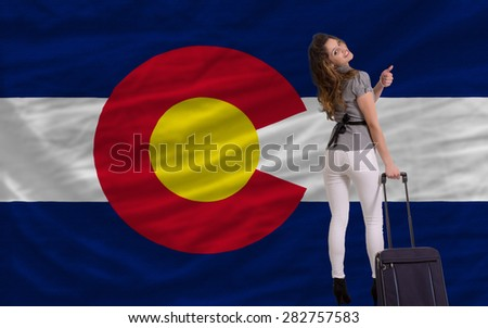 young beautiful woman is traveling to colorado - stock photo