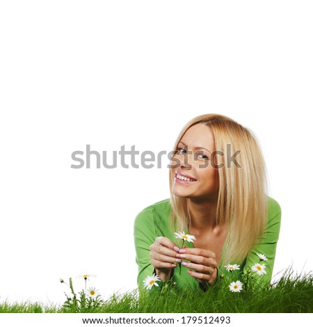 Young beautiful woman laying on daisy flowers field isolated on white background - stock photo
