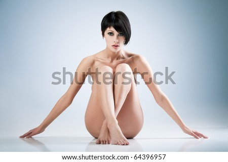 Young beautiful woman on blue background - stock photo