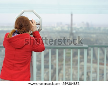 Young beautiful woman on observation deck in Montparnasse building in Paris, France - stock photo