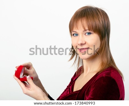 young beautiful woman opens the ring box - stock photo