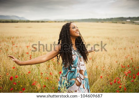 Young beautiful woman outdoors - stock photo