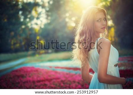 Young beautiful woman outdoors - stock photo