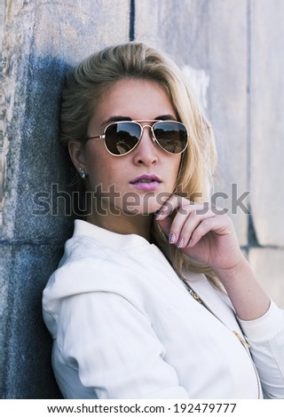young beautiful woman outside in park - stock photo