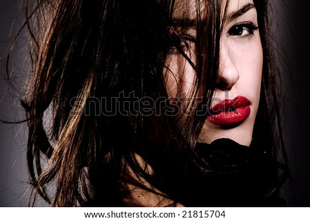 young beautiful woman portrait, black tones - stock photo