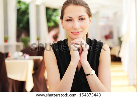 Young beautiful woman portrait in cafe - stock photo