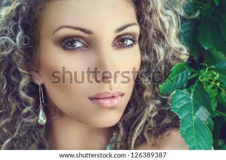 Young beautiful woman portrait in park sunny summer day - stock photo