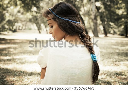 young beautiful woman portrait  in white dress and blue beads in hair, profile, outdoor summer day in forest - stock photo