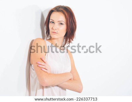 young beautiful woman portrait on white posing - stock photo