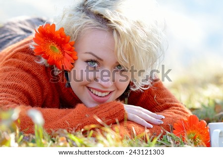 young beautiful woman portrait outdoor in autumn - stock photo