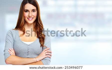 Young beautiful woman portrait over blue background. - stock photo