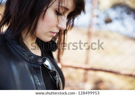 Young beautiful woman portrait, rocker wearing. - stock photo